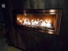 brand new linear gas fireplace from Mendota with copper panoramic interior, driftwood and stones media and antique copper trim. Seen at #HPBEXPO interior, antiqu copper, stone media, gas fireplaces