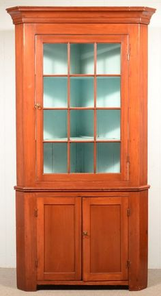 Sold $1,200 Pennsylvania Country Federal Cherry Two Part Corner Cupboard, Circa. 1830-1850. Cove molded cornice, single 12 pane glazed upper door, above...