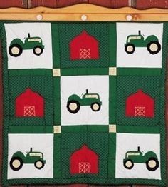 Know a tractor fan? Embroider his (or her) name on a square in this  bright DIY Tractor and Barn Quilted Wall Hanging. Click through for how-tos.