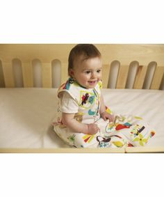Grobag Travel Sleeping Bag 1 Tog - Carnival. A clever travel opening allows a 5 point travel harness from a car seat or pushchair to pass through.