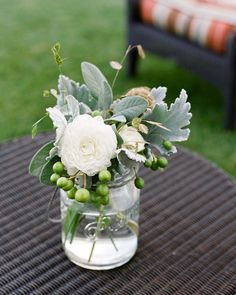 Old mason jars filled with succulents, berries and peonies