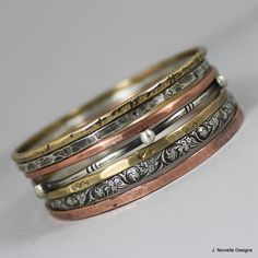 Mixed Metals Jewelry - Bangle Bracelets - Sterling Copper Brass Bangles - Handmade Artisan Bohemian Bracelets - Stack of 7. $152.00, via Etsy.