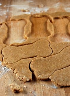 Peanut Butter Dog Biscuits:  2 cps whole wheat flour  1 cp natural peanut butter *  1 cp skim milk  1 tbsp baking powder  Preheat oven to 375  Combine the flour and baking powder in a bowl.Mix the peanut butter and milk in another bowl add to the dry ingr. Mix, then knead into a firm dough with your hands.  Roll out to 1/4″ thick and use a dog bone cookie cutter to cut into cute shapes Place on a cookie sheet about 1/2″  apart. Bake for 20- 25 min or until dried. Makes about 7 dzn 2″ biscuits.