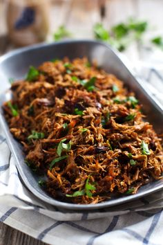 Super Easy Crockpot Shredded Pork - and a trick for getting those deliciously golden crispy bits! | pinchofyum.com