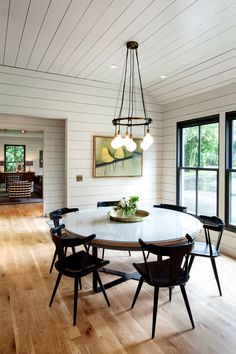 dining rooms, chair, dine room, kitchen tables, light fixtures, white walls, black windows, round tables, wood walls