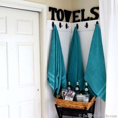 Easily organized Towel Wall - find someway to name them - have a lovely assortment of different colors that still reflect the style of the room overall? These can all be kept in a cupboard or shelves beside the hooks.