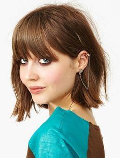 A playful choppy bob with bangs. on The Fashion Time  http://thefashiontime.com/3-gorgeous-medium-bob-hairstyles-for-the-modern-vixen/#sg13