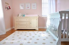 Orchid Pink (Benjamin Moore) walls with a Palladian Blue (Benjamin Moore) crib... Gold accents add a dazzling sparkle to this room... by designer Lindsay Redd