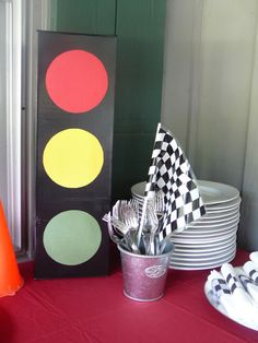 """We also made """"traffic lights"""" to use as decor throughout the party. We saved up milk cartons, instant oatmeal boxes {the ones that come with packets}, and other rectangular boxes around the house for a week or two. Mike spray painted them black and glued red, yellow, and green circles to the boxes. Voila...free traffic lights!"""