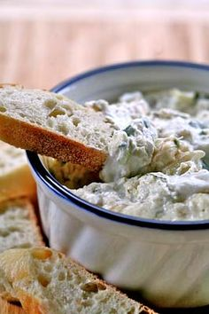 Hot crab dip recipe with cream cheese and mayo base, lump crab meat, green onions, parsley, horseradish, slivered almonds, and Tabasco.