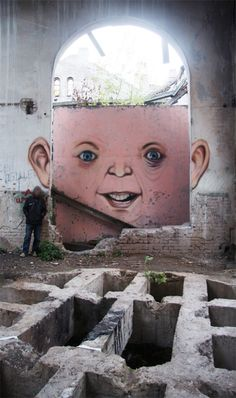 """""""With a double dose of wit and color street artist Nomerz transforms derelict buildings, towers, and crumbling urban spaces into whimsical, quirky faces in locations around Nizhny Novgorod, Russia."""""""