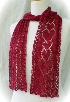 "Say ""I'm thinking of you"" with a hand knit scarf of lace hearts. Simple and quick to knit on just 29 stitches. The scarf begins with a wavy eyelet rib stitch symbolizing the twists and turns of life, and ends with a band of interlocking hearts to express the bonds of loving friendship."