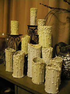 Make candles using toilet paper rolls, tin cans or other tube shaped objects by dripping hot glue on the sides and painting. Insert a candle in the cans (never in paper tubes) or a battery operated candle.