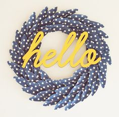 hello + feather wreath