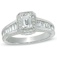 An octagonal border, set with shimmering round accent diamonds, surrounds this center stone