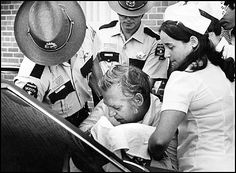 Roger Caldwell Taken Into Custody, Duluth, MN, 1977. The bodies of 83-year-old lumber and mining heiress Elisabeth Congdon and her nurse, Velma Pietila, were found inside the Congdon family's Duluth mansion—Glensheen—on the morning of June 27, 1977. Congdon's daughter, Marjorie Caldwell, and Caldwell's husband, Roger Caldwell, were soon charged with the murders. Roger was convicted.