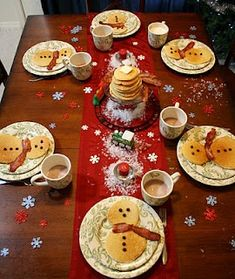 North Pole breakfast - pancake snowmen with bacon scarves and chocolate chip buttons!.
