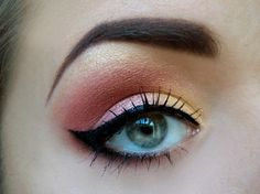 gold, pink, orange eyeshadow blended beautifully with a winged eyeliner