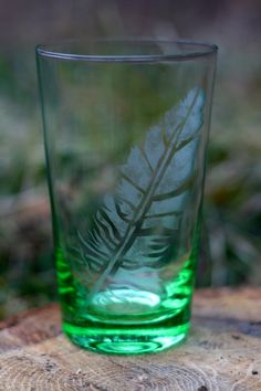 Etched Feather on Green Pint Glass. $8.00, via Etsy.