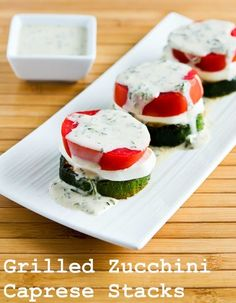 stacks of grilled zucchini, fresh mozzarella, and tomato topped with basil vinaigrette