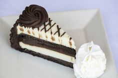 #Chocolate Cake #Cheesecake: Layers of our Original Cheesecake, moist #fudge #cake and chocolate truffle cream.