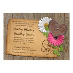 Rustic rusty heart, pink gerber daisy and white shasta daisy on a wood background wedding invitations. Perfect for a rustic style or country wedding or a wedding in the outdoors or a barn or farm wedding. Unique design. The text is easy to personalize as well.   $2.15 per card on basic paper. Volume discounts available up to 45% off. Different paper types to choose from too.   #weddings #weddinginvitations #weddinginvites #rusticwedding #countrywedding