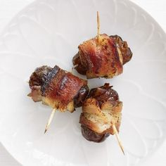 Chorizo-Filled Dates Wrapped in Bacon // More Fast Hors d'Oeuvres: http://www.foodandwine.com/slideshows/fast-hors-doeuvres #foodandwine