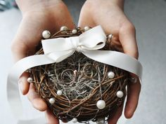 Pearls add a pretty touch to a rustic ring nest.