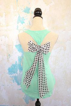 I love to tie Celeste's tank tops with fabric/ribbon.