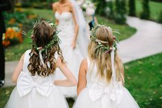 flower girls with bows, photo by Brooke Courtney Photography http://ruffledblog.com/sophisticated-wedding-at-moonstone-manor #flowergirls #wedding