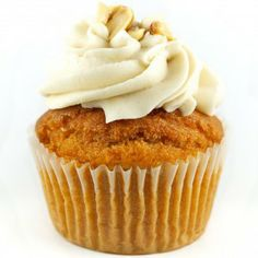 Coconut Curry: Lightly sweet curry cake with coconut creme filling and lime frosting topped with crushed peanuts.