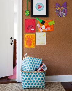 Artwork and inspiration attached to cork-covered walls.