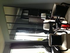 """DIY floor mirrors. I had MDF cut to size at Home Depot and painted the edges black. Bought inexpensive door mirrors at Target and removed the frames. I glued them onto the MDF using construction mirror adhesive. Each mirror has two door mirrors on it stacked vertically. I then took another door mirror and used a glass cutter to make little mirror """"tiles"""" that I glued over the seams. All together these five mirrors cost about $150.00. They each measure 12 3/8"""" wide and 8' tall."""