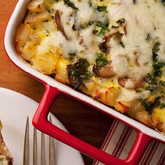 Add hash brown potatoes, fresh herbs, and mushrooms to a basic egg casserole to create this hearty breakfast dish.