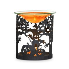 "A happy haunting scene crafted of black metal. Use as a holder for pillar candles or large tealights, sold separately. With the included glass dish, use with Scented Oil or Scent Plus® Melts and a tealight, also sold separately. 5""h, 4 3/4""w.  Price:  $10.00 each"