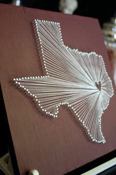 Nail + string. Make it for your state with your heart in the city of choice. Love this idea!