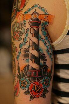 A very pretty, simple lighthouse tattoo by Jason Donahue