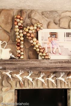 A new twist on the ornament wreath -- make it a monogram! Visit Remodelaholic.com for the #tutorial #diy #Christmas #decor