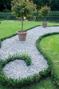 Heritage garden, elegant gravel garden, Buxus sempervirens-low box hedge, grass, lawn, Lantana-shrub verbena in pot, big pond, water