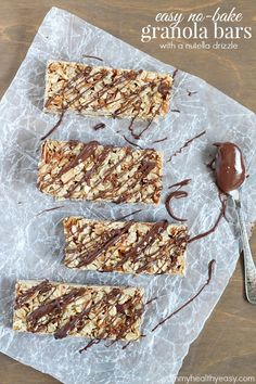 Easy No-Bake Granola Bars  - simple granola bars with oats, almonds and coconut with a delicious chocolate  nutella drizzle on top.