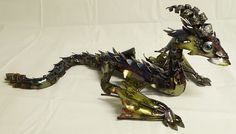 Posable Shoulder Dragon - Steel Sculpture. $200.00, via Etsy.