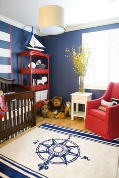 Beautiful nautical nursery design with navy, white and red color palette