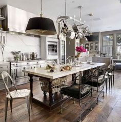 Gwyneth Paltrow's Kitchen in L.A. - LOVE the floors, island, metal tub chairs, pendants, overall casual, lived-in feel