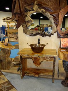custom maple burl vanity with natural live edge wood slabs and burl wood mirror.