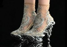 McQueen. I have never seen shoes that only a queen should wear until now.