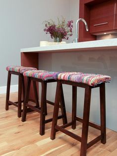 Rag-rug upholstered barstools add such an unexpected pop of color!
