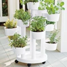 "Self-Watering Planter. Thanks to its clever design, this ""bunch"" planter boasts room for 10 lush plants--all watered from one drainage grid that supplies continuous H2O for healthy roots!"