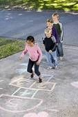 We would teach the kids to play Hopscotch.
