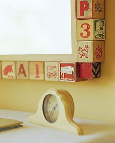 Old wooden baby blocks used as a mirror frame - I love this!  Now to find some vintage blocks!
