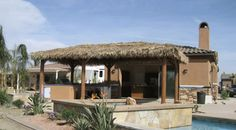 A palapa is a tropical-inspired take on the patio cover. Designed to evoke sunshine-drenched getaways, the palapa's a great choice in desert or tropical-style landscapes. Design shown is by Palapa Kings in Oceanside, CA. Get more patio cover design tips here: http://www.landscapingnetwork.com/pergolas/patio-cover-design.html
